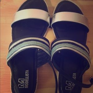 Cute silver and turquoise sandals.